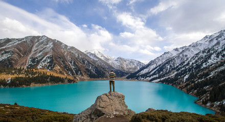 a man stands on a mountain, a mountain lake, glaciers.Big Almaty Lake, Kazakhstan, Almaty