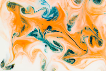 Artistic abstract design created with mixing color liquids. Colorful background texture. Liquids mixing on water surface