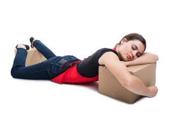 Supermarket seller sleeping on carton box