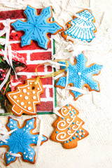 Ginger delicious gingerbread in the form of snowflakes and fir trees, isolated on white background. Holiday gift