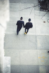 Gay Men Lovers Walking Together Hand in Hand in a New York Street Sidewalk