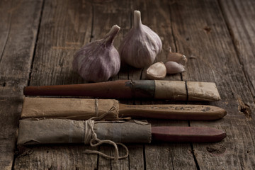 old paint brushes with garlic