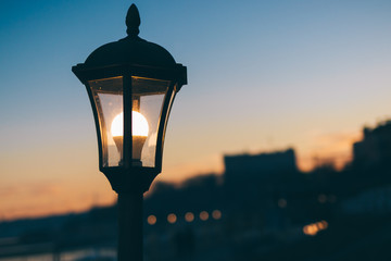 Glowing street lamp in the city