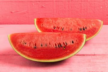 slice of ripe watermelon on wood pink
