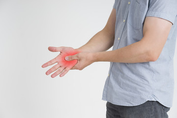 Pain in hand, carpal tunnel syndrome on gray background