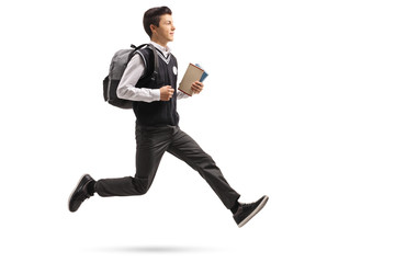 Teenage student with a backpack and books in mid-air