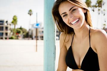 beautiful young woman smiling at the beach.