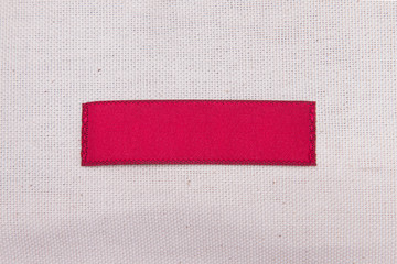 A piece of red cloth sewn to the textile