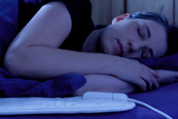 woman sleeping electric heating blanket