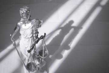 Woman statue symbol of justice Themis