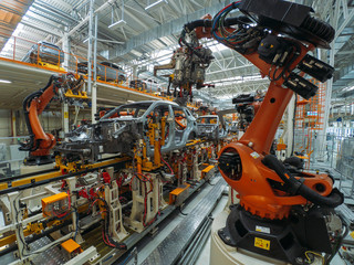 Automobile plant, welding process, modern production of cars, robot equipment, automated production line.