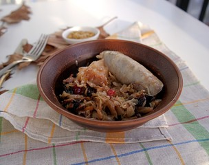 Delicious stewed cabbage with pork sausages, apples and cranberries
