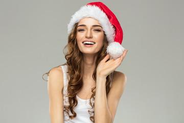 Smiling beautiful woman wear santa hat