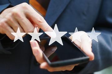 Business key rating increase web icon on phone.