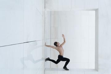 Shirtless man in jump