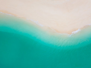 Summer Beach top view or aerial view showing shade of emerald water and wave