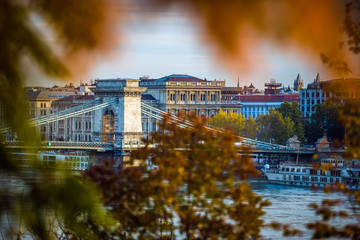 Budapest, Hungary - The famous Szechenyi Chain Bridge in the morning with autumn foliage
