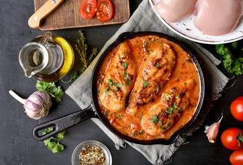 Cooked chicken breast with tomato sauce