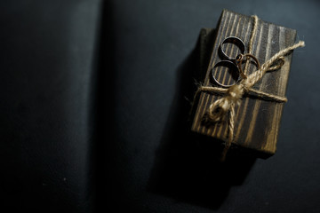 Wedding rings lie on wooden box