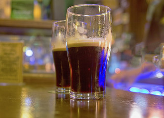 Two stouts on bar