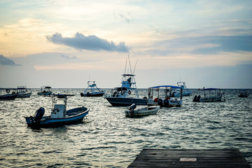 Boats in Anchored Ocean Harbor at Sunrise Mexico
