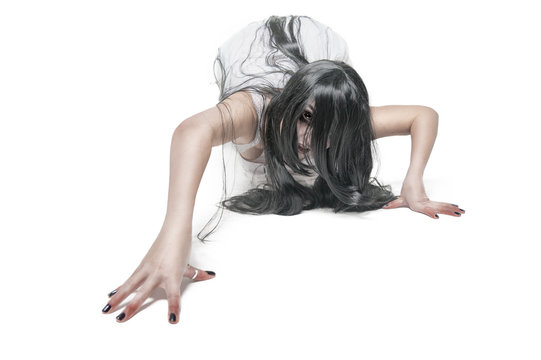 Mystical ghost woman in white long shirt crawl on white