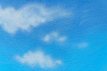 blue sky and white clouds painted on the wall