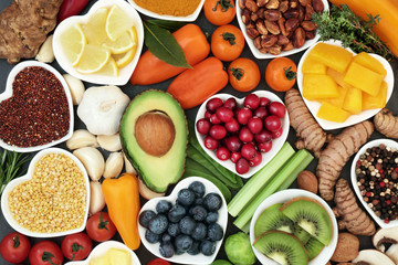 Health food for fitness concept with fruit, vegetables, pulses, herbs, spices, nuts, grains and...