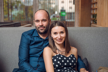 Smiling couple sitting on couch