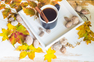 Autumnal concept with yellow leaves and coffee