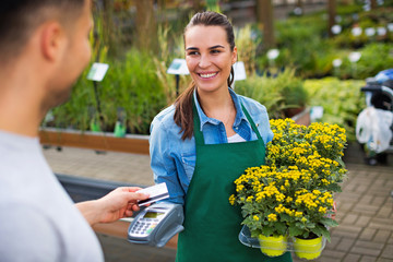 Paying with credit card at garden center