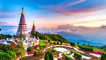 Wall Mural - The best of landscape in Chiang mai. Pagodas Noppamethanedol & Noppapol Phumsiri at sunset in Inthanon mountain, Thailand. Time lapse 4K.