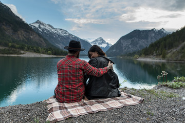Hipster couple enjoys nature and mountains in Austria