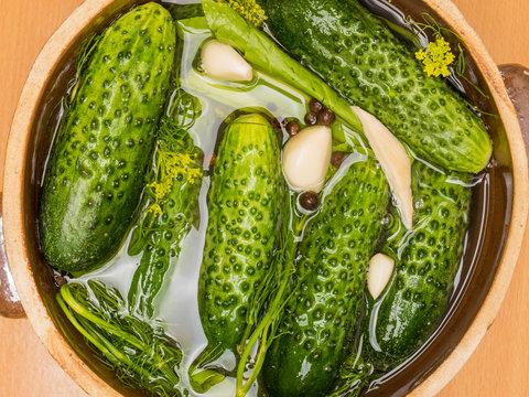 Making pickled cucumbers in clay jar