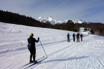 cross country skiing in a row