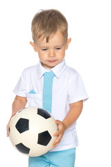 A little boy is playing with a ball.