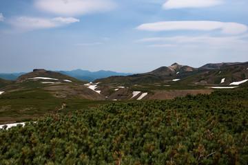 Panoramic view on green slopes around Mount Kurodake, Daisetsuzan National Park, Hokkaido, Japan