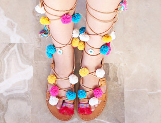 greek leather sandals with colorful pom pom and evil eye