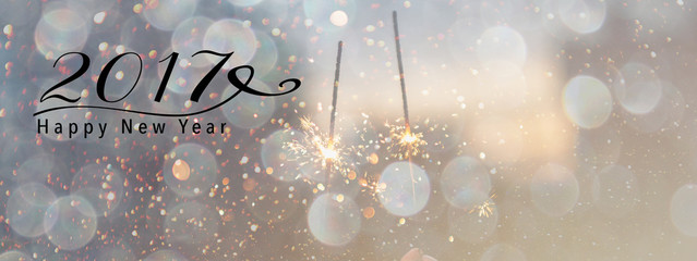 Bokeh effect on top of Sparklers. Panoramic size, happy new year quote