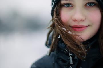 Beautiful girl teen smiles in winter