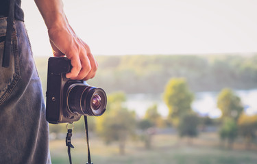 Photographer's hand with camera