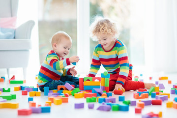 Wall Mural - Kids play with toy blocks. Toys for children.