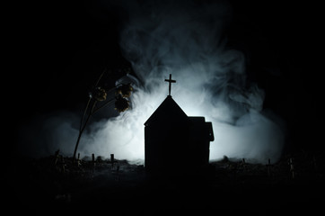 Scary view of zombies at cemetery dead tree, moon, church and spooky cloudy sky with fog, Horror Halloween concept Fotomurales