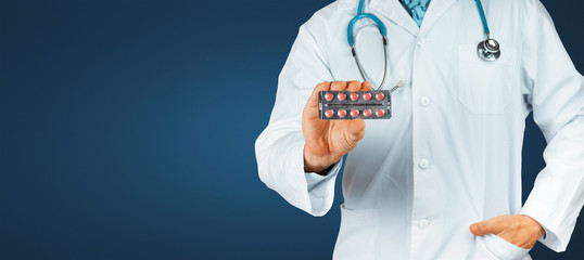 This Will Help. Doctor Holding Blisters With Red Pills, Close-up