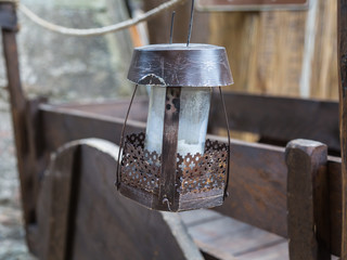 Old Iron Hanged Lamp, Wooden Brown Cart in background