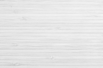 White wood texture bamboo wooden kitchen cutting board grainy detail background in light grey color