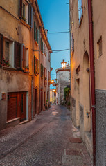 Narrow street in the old town at night in Italy
