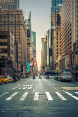 Tuinposter New York TAXI Tilt-shift view of a crosswalk in a New-York city avenue, USA