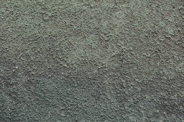 Green painted dirty stucco wall. Background texture