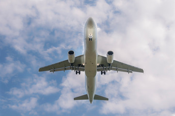 Commercial Passenger Plane Jet Aircraft from Below before landing